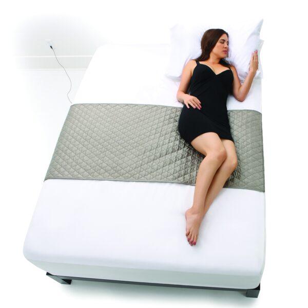 1200x1200_plush_silver_sleep_pad_model_on_bed_small_horizontal