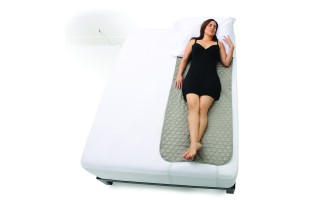 1200x1200_plush_silver_sleep_pad_model_on_bed_small_vertical